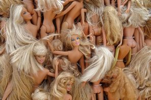 Close up of a pile of undressed Barbie dolls to indicate there is no such thing as a perfect body