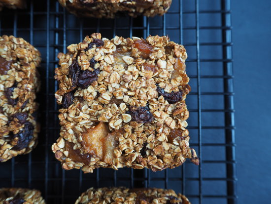Close up of a square apple cinnamon and raisin flapjack on a wire cooling rack