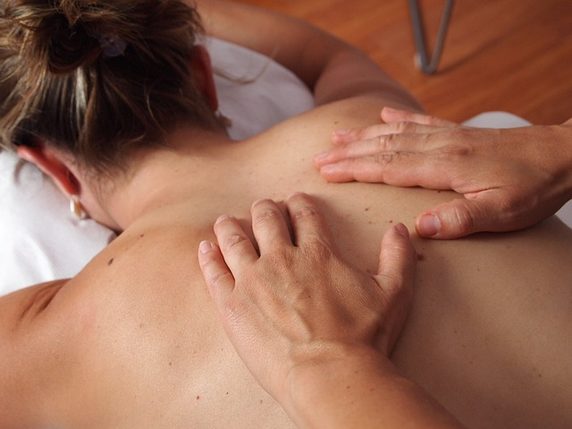 close up of a female's back receiving a massage to relax her mucles