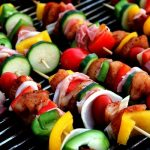 Close up of vegetable and meat skewers on a BBQ grill showing that their are healthy alterantives to grilling