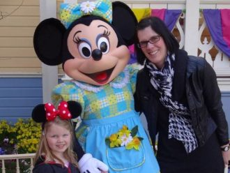 Mother and Daughter stood either side of Minnie Mouse character at Disneyland Paris