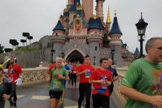 Runners running through Sleeping Beauty's castle at Disneyland Paris