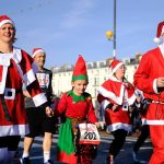 Family dressed as santas and elves running in a charity race