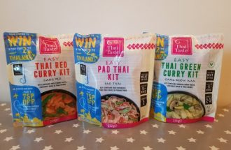 Three packets of Thai Taste mEAL kit pouches lined up on a table.