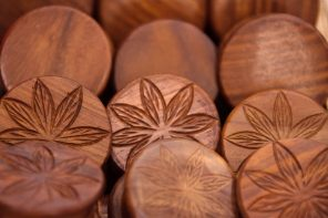 wooden discs with imprint of cannabis leaves on them to indictae the benefits of cbd for health and wellness