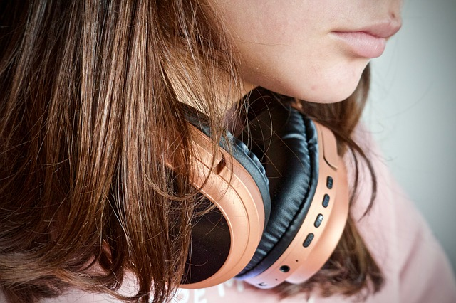 Close up of a woman wiith headphone round her neck
