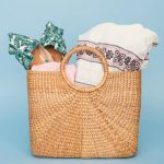 Basket style handbag filled with things you would need to take with you on a wellness retreat