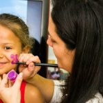 Child getting her face painted