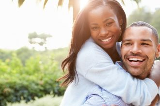 Young black couple smiling at the camera