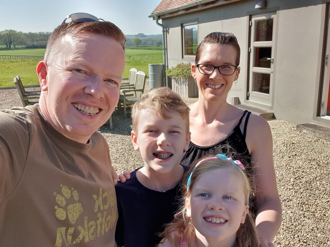 the four members of the Stafferton family smiliing on holiday in Dorset. reflections on how fast the children are growing up.